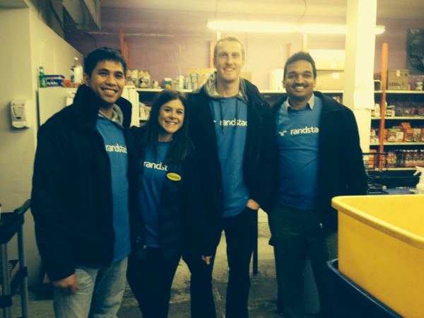 Randstad Canada Technologies and Staffing Teams in Victoria Stack Food at local food bank